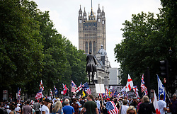 © Licensed to London News Pictures. 14/07/2018. London, UK. Supporters of U. S President Donald Trump and Tommy Robinson at a rally on Whitehall, central London. Trump is on his third day of a 4 day visit to the UK, which so far has seen him hold talks with British PM Theresa May and meet HRH Queen Elizabeth II. Photo credit: Ben Cawthra/LNP