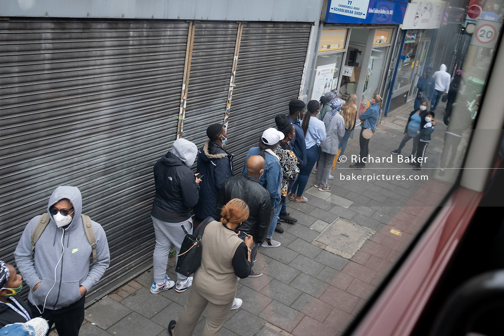 Ad the new school term restarts in England, and after the long closure during the Coronavirus pandemic, shoppers queue outside the school  unirom outfitters 'White Hall Clothiers' (established in1883) on the Walworth Road in Camberwell, on 29th August 2020, in London, England.