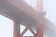 The Golden Gate Bridge, shrouded by fog. San Francisco, California.