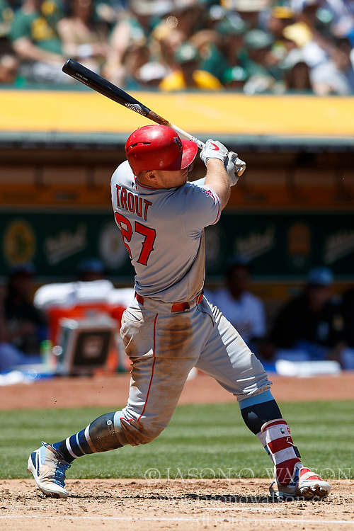 OAKLAND, CA - JUNE 17: Mike Trout #27 of the Los Angeles Angels of Anaheim at bat against the Oakland Athletics during the third inning at the Oakland Coliseum on June 17, 2018 in Oakland, California. The Oakland Athletics defeated the Los Angeles Angels of Anaheim 6-5 in 11 innings. (Photo by Jason O. Watson/Getty Images) *** Local Caption *** Mike Trout