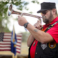 """Wyatt Stiger plays """"Taps"""" on a bugle at the start of the Quilts of Valor ceremony at the University of New Mexico-Gallup North Campus in Gallup Friday."""