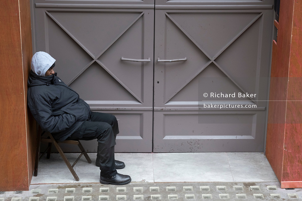 A man sits in a chair at the entrance to a commercial property in Holborn, on 19th February 2021, in London, England. (Photo by Richard Baker / In Pictures via Getty Images)