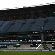 Cars practice in front of the front stretch construction during the 57th Annual NASCAR Coke Zero 400 practice session at Daytona International Speedway on Friday, July 3, 2015 in Daytona Beach, Florida.  (AP Photo/Alex Menendez)