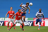 John Swift of Reading jumps over Nahki Wells of Huddersfield Town to head the ball. EFL Skybet  championship match, Reading  v Huddersfield Town at The Madejski Stadium in Reading, Berkshire on Saturday 24th September 2016.<br /> pic by John Patrick Fletcher, Andrew Orchard sports photography.