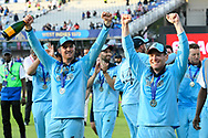 Jason Roy of England and Eoin Morgan of England celebrating on the lap of honour after winning the Cricket World Cup during the ICC Cricket World Cup 2019 Final match between New Zealand and England at Lord's Cricket Ground, St John's Wood, United Kingdom on 14 July 2019.