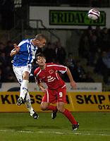Photo: Matt Bright/Sportsbeat Images.<br /> Brighton & Hove Albion v Carlisle United. Coca Cola League  1. 24/11/2007.<br /> Joel Lynch of Brighton heads clear of  Danny Graham of Carlisle