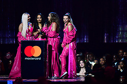 (Left to right) Jesy Nelson, Leigh-Anne Pinnock, Jade Thirlwall and Perrie Edwards of Little Mix accept the award for British Artist Video of the Year on stage at the Brit Awards 2019 at the O2 Arena, London.