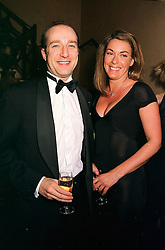 TV hypnotist MR PAUL McKENNA and MISS GRAINNE LAWLER, at a dinner in London on 17th February 2000.OBE 39