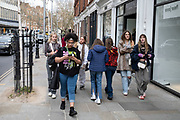 Group of young women out in the upmarket area of Chelsea on 14th April 2021 in London, United Kingdom. Chelsea is one of the principal areas for exclusive, luxury goods in West London. It is known as a district where the rich and wealthy shop, mostly for high street and high end fashion and jewellery.