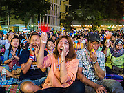 03 JANUARY 2014 - BANGKOK, THAILAND: Anti-government protestors in Bangkok cheer for Suthep Thaugsuban. Thousands of Thai anti-government protestors came to Democracy Monument in Bangkok Friday night to hear Suthep Thaugsuban, the leader of the protests, announce his plans to shut down the city of Bangkok. Suthep said his protestors would occupy 20 major intersections in the commercial sections of Bangkok for up to three weeks or until the caretaker government of Yingluck Shinawatra resigns.     PHOTO BY JACK KURTZ