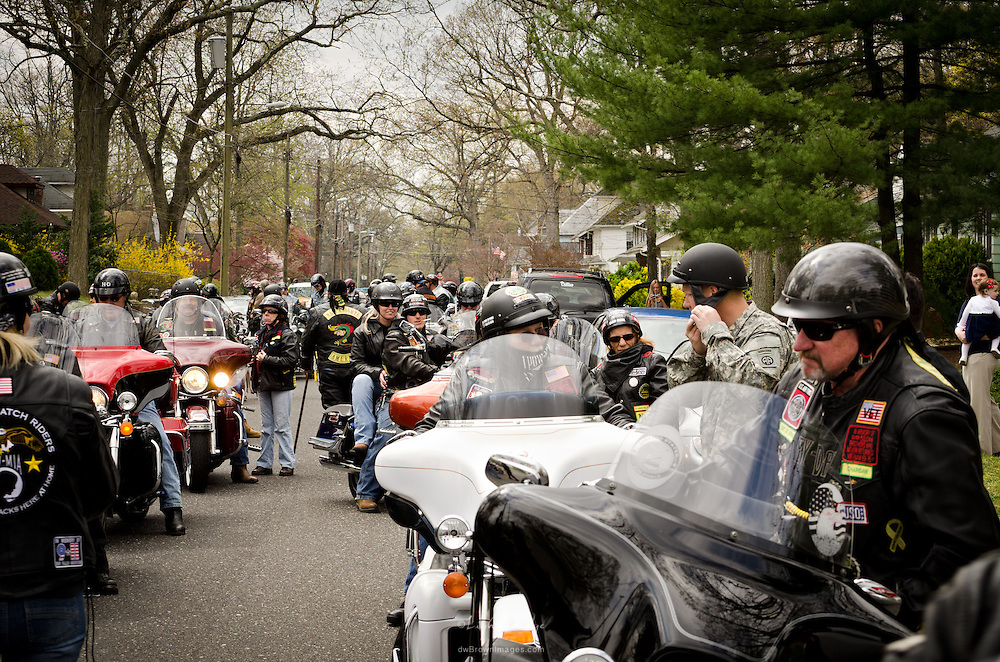 Jacob Newcomb dons a helmet as he prepares for a tribute welcome home ride with Warriors' Watch and others.