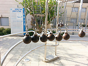 Newton's Cradle at the Carasso Science Park and museum, Israel Beer Sheva.