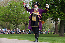 Windsor, UK. 22nd April 2019. Chris Brown, Official Town Crier of the Royal Borough of Windsor and Maidenhead, invites the public to sing 'Happy Birthday' to the Queen ahead of the traditional 21-gun salute on the Long Walk in front of Windsor Castle to mark her 93rd birthday.