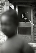 A mother keeps watch over her child as he plays nearby at Atlanta's East Lake Meadows public housing project during the period of the Atlanta Child Murders.