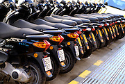 Motorbikes for rent, parked in a row