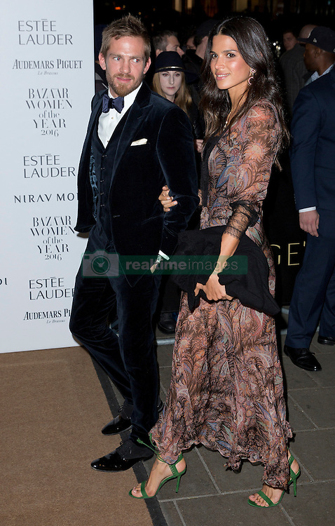 Jacobi Anstruther-Gough-Calthorpe and Raica Oliveira attending the Harper's Bazaar Woman of the Year awards at Claridges in London. Picture date: Monday October 31, 2016. Photo credit should read: Isabel Infantes / EMPICS Entertainment.