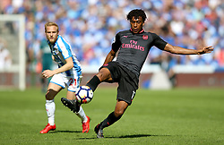 Arsenal's Alex Iwobi (right) and Huddersfield Town's Alex Pritchard battle for the ball