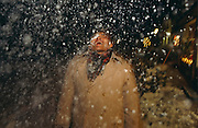 A tourist from Singapore feels the sensation of falling snow on his face during a European tour taking in the German Alps.
