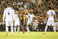 Real Madrid´s Di Maria (R) and F.C. Barcelona´s Andres Iniesta during the Spanish Copa del Rey `King´s Cup´ final soccer match between Real Madrid and F.C. Barcelona at Mestalla stadium, in Valencia, Spain. April 16, 2014. (ALTERPHOTOS/Victor Blanco)