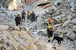 August 29, 2016 - Amatrice, RIETI, ITALY - Europe, Italy, Amatrice, August 29, 2016: During the night of august 24 at 3.36 am a a strong earthquake hits the city of Amatrice and the small villages around causing the distruction of the area and the collaps of the buildings  297 are the deaths and hundreds are the disappeared. the search for victims and of bodies continues. without interruption during the night. (Credit Image: © Danilo Balducci   Photographer via ZUMA Wire)