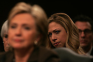 Chelsea Clinton watches her mother,Senator Hillary Rodham Clinton as she  testifies at a Senate confirmation hearing for Senator Clinto to become Secretary of State.  Photo by Dennis Brack