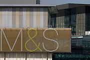 A large sign of British retail giant, Marks & Spencer on the outside of their branch at Westfield City shopping centre in Stratford.