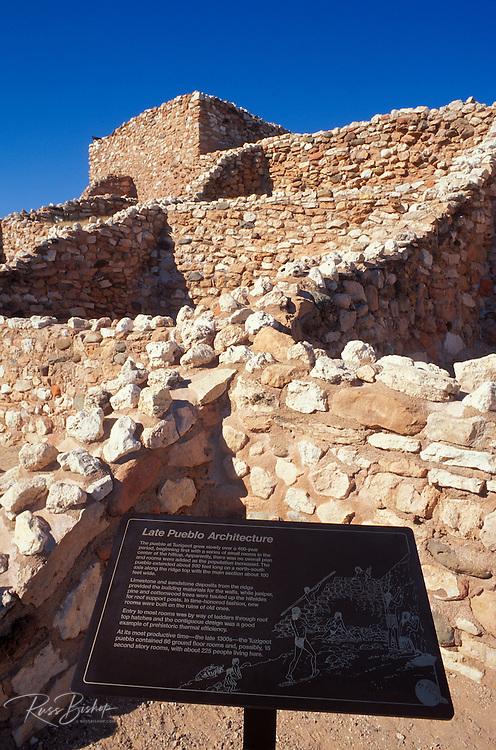 Pueblo rooms and watch tower behind sign describing late pueblo architecture  (Sinagua Indians), Tuzigoot National Monument, Arizona.