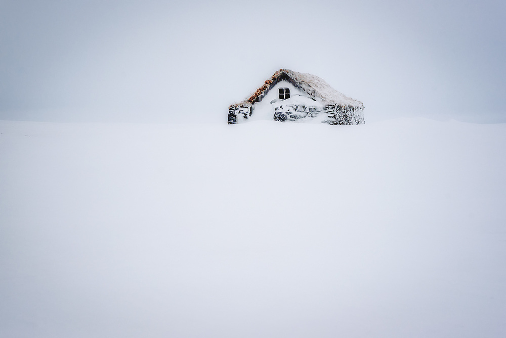 Snow covered cabin in Iceland