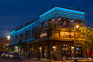 Full moon rises behind Caseys Bar along Central Avenue at dusk in downtown Whitefish, Montana, USA