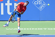 JACK SOCK hits a serve during his semifinal match at the Citi Open at the Rock Creek Park Tennis Center in Washington, D.C.