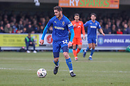 AFC Wimbledon defender Tyler Garratt (12) dribbling during the The FA Cup 5th round match between AFC Wimbledon and Millwall at the Cherry Red Records Stadium, Kingston, England on 16 February 2019.