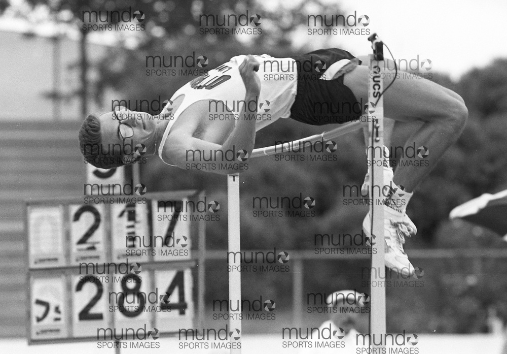 ******This is an unprocessed scan from the negative. You can buy it as is and clean it up yourself, or contact us for rates on providing the service for you. *******<br /> <br /> (Montreal, Canada---18-21 June 1992) Corey Siermachesky in the high jump at the 1992 Canada Track and Field Olympic Trials as the complexe sportif Claude-Robillard in Montreal. Photo 1992 Copyright Sean Burges / Mundo Sport Images.<br /> <br /> ******This is an unprocessed scan from the negative. You can buy it as is and clean it up yourself, or contact us for rates on providing the service for you. *******