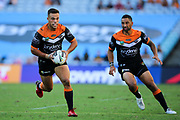 Luke Brooks of the Tigers on attack. Wests Tigers v Sydney Roosters. NRL Rugby League. ANZ Stadium, Sydney, Australia. 10th March 2018. Copyright Photo: David Neilson / www.photosport.nz