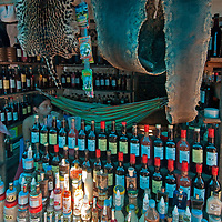 Anaconda and Jaguar skins (which are for sale) decorate a shop selling potions in an outdoor market in upper Belem, a crowded neighborhood in Iquitos, Peru.