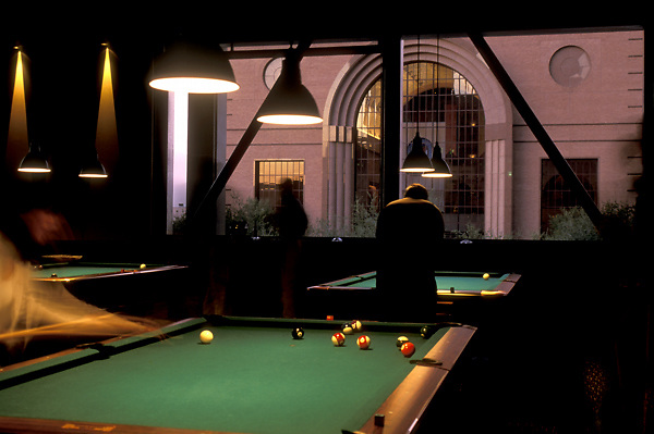 Stock photo of shooting a game of billiards at a pool hall