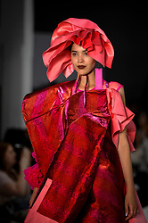 © Licensed to London News Pictures. 06/06/2018. LONDON, UK.  A model presents a look by Chantelle Guan from Ravensbourne at the Best of Graduate Fashion Week 2018 show at the Old Truman Brewery in East London. The event presents the graduation show of up and coming fashion designers from UK and international universities.  Photo credit: Stephen Chung/LNP