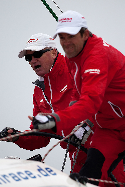 Peter Gilmour (L) during day 1 of Match Race Germany. World Match Racing Tour. Langenargen, Germany. 20 May 2010. Photo: Gareth Cooke/Subzero Images/WMRT