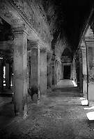 Looking down a corridor in the ancient Angkor Wat temples, Siem Rep, Cambodia.