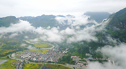 August 27, 2017 - China - Guizhou, CHINA-27th August 2017: (EDITORIAL USE ONLY. CHINA OUT) ..Mist envelops mountains in Wangmo County, southwest China's Guizhou Province, August 27th, 2017. (Credit Image: © SIPA Asia via ZUMA Wire)