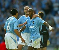 Photo Aidan Ellis.<br />Manchester City v Aston Villa.<br />FA Barclaycard Premiership.<br />14/09/2003.<br />City's Nicolas Anelka celebrates his hat trick with Antoine Sibierski and Claudio Reyna