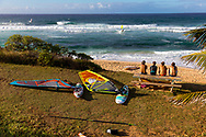 Windsurfers hanging out on shore at Ho'okipa Beach Park, Paia, Maui, Hawaii, USA