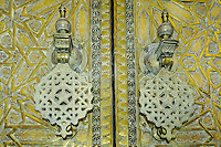 Morocco. The gate to the royal palace in Fes with heavy bronze doors. Door detail.
