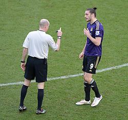 Referee talks to West Ham's Andy Carroll - Photo mandatory by-line: Alex James/JMP - Mobile: 07966 386802 - 25/01/2015 - SPORT - Football - Bristol - Ashton Gate - Bristol City v West Ham United - FA Cup Fourth Round