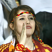 Galatasaray's supporter girl on the demonstration during their Turkish Super Cup 2012 soccer derby match Galatasaray between Fenerbahce at the Kazim Karabekir stadium in Erzurum Turkey on Sunday, 12 August 2012. Photo by TURKPIX