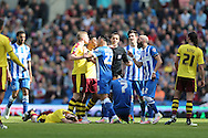 Burnley midfielder Joey Barton (13) injured after making a rash challenge during the Sky Bet Championship match between Brighton and Hove Albion and Burnley at the American Express Community Stadium, Brighton and Hove, England on 2 April 2016.
