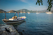 Selimiye, Bozburun, Turkey, October 2015. The cozy waterfront of Selimiye is mostly visited by Turkish Tourists. Situated roughly between the seaside resorts of Marmaris and Bodrum and the Latmos mountains in the east lies Ancient Caria. The Carian Trail runs through pine scented forests along the coastal mountains of Western Turkey and is littered with ancient ruins, secluded coves with turquoise waters and little villages. more than 800km of ancient roads, shepherd paths and forest trails form Turkey's longest hiking trail. Photo by Frits Meyst / MeystPhoto.com