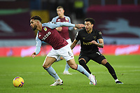 Football - 2020 / 2021 Premier League - Aston Villa vs West Ham United - Villa Park<br /> <br /> Aston Villa's Douglas Luiz holds off the challenge from West Ham United's Jesse Lingard.<br /> <br /> COLORSPORT/ASHLEY WESTERN