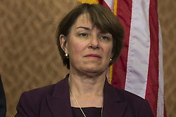 October 3, 2017 - Washington, District Of Columbia, USA - Senator AMY KLOBUCHAR (D-MN) looks on during a press conference on gun violence held by Senate Democrats at the United States Capitol. The group of lawmakers demanded new legislation to bring forward gun control measures in response to the mass shooting in Las Vegas. (Credit Image: © Alex Edelman via ZUMA Wire)