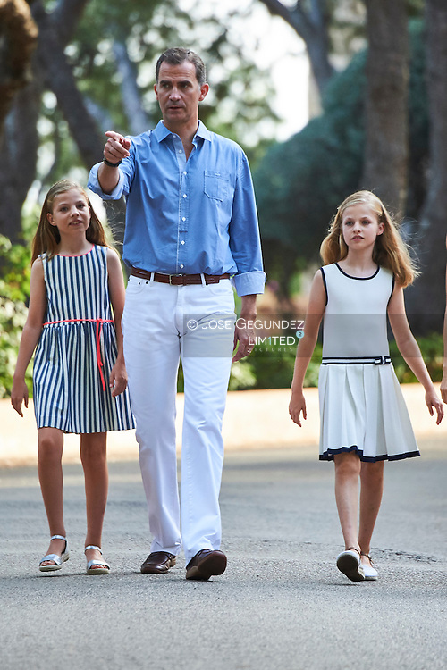 Crown Princess Leonor, King Felipe VI of Spain pose for the photographers at the Marivent Palace on August 4, 2016 in Palma de Mallorca, Spain.