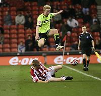 Photo: Mark Stephenson/Sportsbeat Images.<br /> Stoke City v Sheffield United. Coca Cola Championship. 10/11/2007.Sheffield's David Carney jumps over Stokes Ryan Shawcross